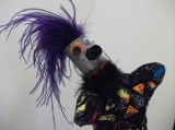 Alf is a completely scrap-made puppet, as is his companion, Elton. Alf's head is a painted aspirin bottle, his nose is a glue cap, and he has mismatched googly eyes that had no mates. His body is a swatch of great old 80's fabric.